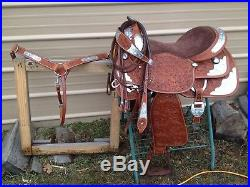 16.5 med oil Western show saddle withsilver, matching breast collar & bridle set
