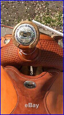 Circle G roping saddle 15 1/2 seat 6 gullet
