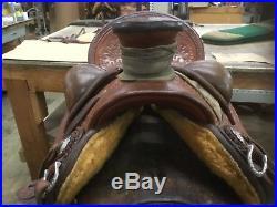 Custom made wade saddle by granite station saddlery full tooled