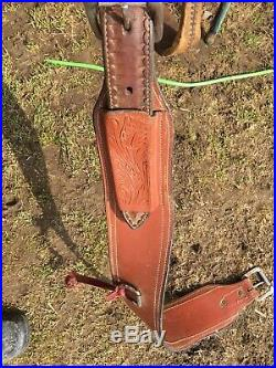 Used 16 Billy Cook Western roping saddle withtooled skirts, rough out fenders