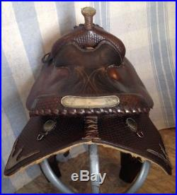 Used/vintage Circle Y 15 Western equitation saddle withsilver, tooled leather